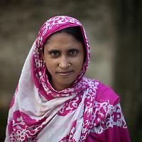 A Bangladeshi woman walks in Dhaka city centre
