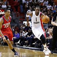 21 January 2012: Miami Heat power forward Chris Bosh (1) brings the ball up court past Philadelphia Sixers shooting guard Evan Turner (12) during the Miami Heat 113-92 victory over the Philadelphia Sixers at the AmericanAirlines Arena, Miami, Florida, USA.