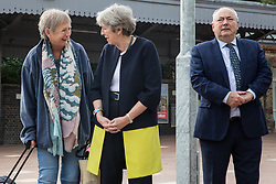 A member of the public speaks to Theresa May, Conservative MP for Maidenhead, on the occasion of the official opening of a new station forecourt on 11th October 2021 in Maidenhead, United Kingdom. The £3.75m refurbishment is intended to make the area around the station more commuter-friendly in anticipation of an increase in passengers when Crossrail opens and to improve both the interchange between trains and other forms of transport and walking and cycling links between the station and the town centre.
