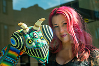 """Jenn Hampton is the co-owner of the Parlor Gallery in Asbury Park. She is pictured by a sculpture called """"Das Bug"""" by Jan Huling. Photo was taken on March 5, 2020."""