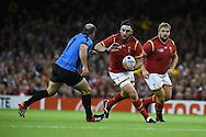 Scott Baldwin of Wales looks to go past Matias Beer of Uruguay. Rugby World Cup 2015 pool A match, Wales v Uruguay at the Millennium Stadium in Cardiff, South Wales  on Sunday 20th September 2015.<br /> pic by  Andrew Orchard, Andrew Orchard sports photography.