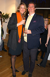 CAMILLA MAY and AXEL VAN DRONGELEN at an exhibition of art by Jeffrey Kroll entitled Imirage held at the Arndean Gallery, Cork Street, London on 19th October 2005.<br /><br />NON EXCLUSIVE - WORLD RIGHTS