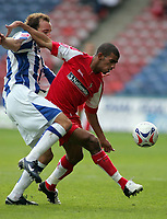 Photo: Paul Thomas.<br /> Huddersfield Town v Swindon Town. Coca Cola League 1. 29/10/2005. <br /> <br /> Swindon's Hameur Bouazza holds of a challenge from David Murfin.
