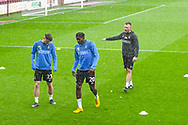 Omari Patrick of Bradford City (20) and Connor Wood of Bradford City (23) warming up in the rain during the EFL Sky Bet League 1 match between Scunthorpe United and Bradford City at Glanford Park, Scunthorpe, England on 27 April 2019.