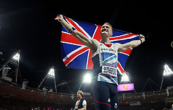 File photo dated 04-08-2012 of Great Britain's Greg Rutherford celebrates after winning the Men's Long Jump