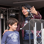 Shappi Khorsandi and her son speaking at the People's Assembly Against Austerity 'End Austerity Now' demonstration attended by over 250,000 people on Saturday 20th of June 2015 sending a clear message to the Tory government; demanding an alternative to austerity and to policies that only benefit those at the top. London, UK.