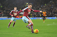 Burnley midfielder Matthew Taylor crosses ball in front of the goal during the Sky Bet Championship match between Hull City and Burnley at the KC Stadium, Kingston upon Hull, England on 26 December 2015. Photo by Ian Lyall.