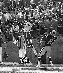 Raiders vs Denver Broncos: Bronco's Thomas leaps for pass but was caught by The Raiders Warren Wells for Touchdown. (photo by Ron Riesterer)