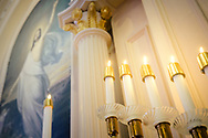 Altar candles and a depiction of Jesus Christ on Saturday, July 10, 2021, at St. Paul Lutheran Church in the Marigny area of New Orleans.  LCMS Communications/Erik M. Lunsford