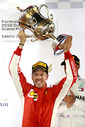April 8, 2018 - Sakhir, Bahrain - Ferrari driver SEBASTIAN VETTEL of Germany celebrates on the podium after winning the Formula One Bahrain Grand Prix. (Credit Image: © Hoch Zwei via ZUMA Wire)