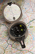 A compass helps guide the traveler along a map. Missoula Photographer