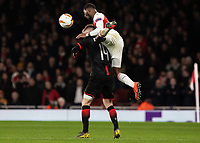 Football - 2018 / 2019 UEFA Europa League - Round of Sixteen, Second Leg: Arsenal (1) vs. Rennes (3)<br /> <br /> Ainsley Maitland-Niles (Arsenal FC) climbs all over the back of Benjamin Bourigeaud (Rennes FC) to reach the ball at The Emirates.<br /> <br /> COLORSPORT/DANIEL BEARHAM