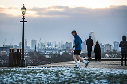 © Licensed to London News Pictures. 10/02/2021. London, UK. The sun rises over the city of London, as seen from Primrose Hill in Camden, north London, on another morning of sub zero temperatures in the capital. Photo credit: Ben Cawthra/LNP