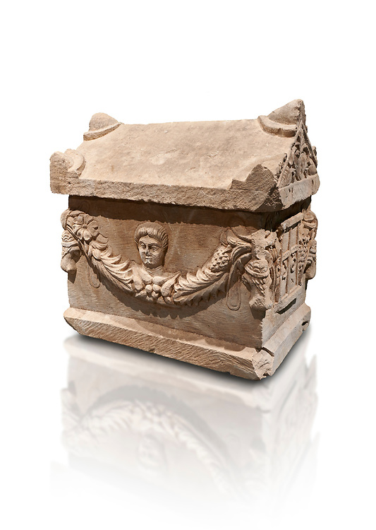 Roman relief decorated garland osthotek cremation container, 2nd century AD. An ostothec is used to preserve the ashes and bones of the dead bodies after their cremation, takes its form from a small sarcophagus. This ostothec is a miniature example of the garland sarcophagus. Adana Archaeology Museum, Turkey. Against a white background .<br /> <br /> If you prefer to buy from our ALAMY STOCK LIBRARY page at https://www.alamy.com/portfolio/paul-williams-funkystock/greco-roman-sculptures.html . Type -    Adana     - into LOWER SEARCH WITHIN GALLERY box - Refine search by adding a subject, place, background colour, museum etc.<br /> <br /> Visit our ROMAN WORLD PHOTO COLLECTIONS for more photos to download or buy as wall art prints https://funkystock.photoshelter.com/gallery-collection/The-Romans-Art-Artefacts-Antiquities-Historic-Sites-Pictures-Images/C0000r2uLJJo9_s0