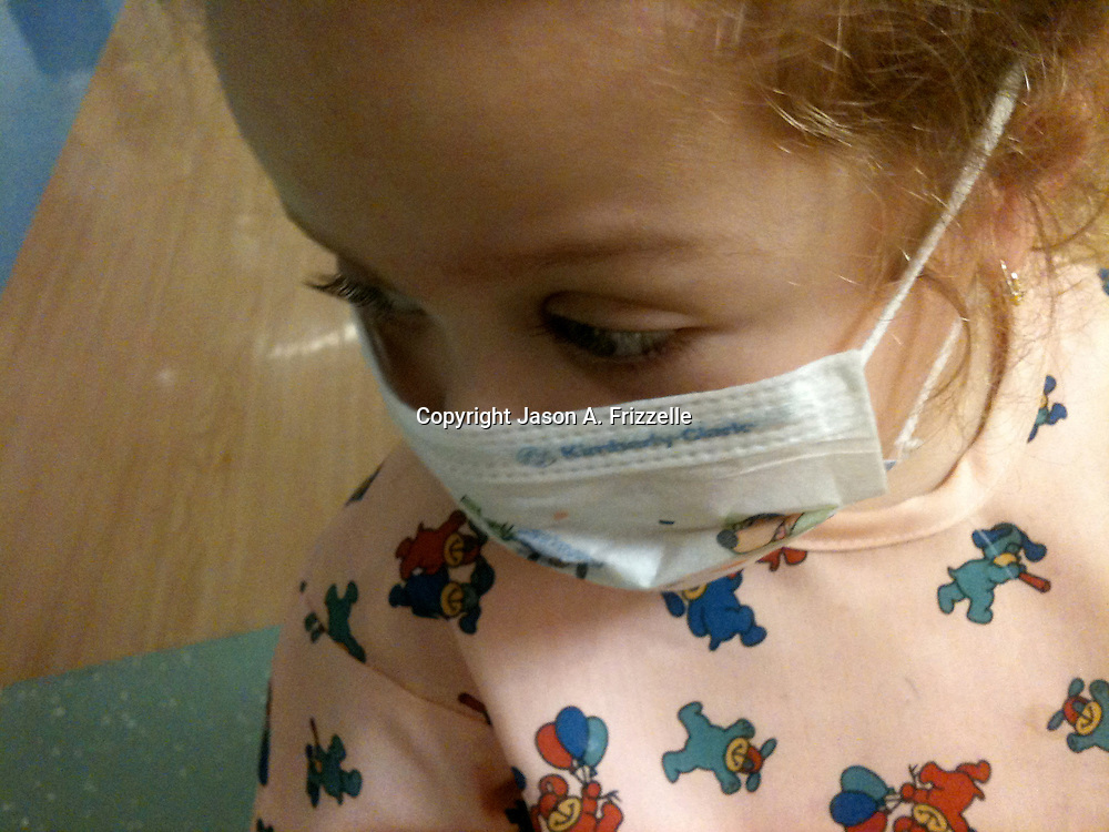 Holly Larue Frizzelle, 2, is pictured in the hallway of UNC Children's Hospital in December of 2012. Larue had just begun chemotherapy and had to wear a mask when she left her room. On December 27, 2012 two year old Holly Larue Frizzelle was diagnosed with Acute Lymphoblastic Leukemia. What began as a stomach ache and visit to her regular pediatrician led to a hospital admission, transport to the University of North Carolina Children's Hospital, and more than two years of treatment.