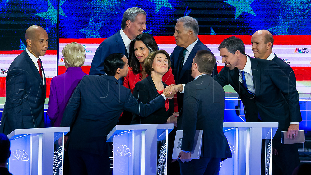 Democratic presidential candidates embrace after the end of the first primary debate for the 2020 elections at the Adrienne Arsht Center for the Performing Arts in downtown Miami on Wednesday, June 26, 2019.