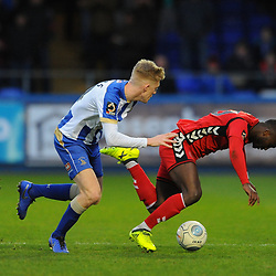TELFORD COPYRIGHT MIKE SHERIDAN 12/1/2019 - Dan Udoh of AFC Telford is knocked off the ball by Nicky Featherstone during the Vanarama Conference North fixture between AFC Telford United and Hartlepool United at the Super Six Stadium.