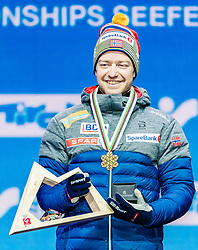 23.02.2019, Medal Plaza, Seefeld, AUT, FIS Weltmeisterschaften Ski Nordisch, Seefeld 2019, Skiathlon, Herren, 30km, Siegerehrung, im Bild Weltmeister und Goldmedaillengewinner Sjur Roethe (NOR) // World champion and Gold medalist Sjur Roethe of Norway during the winner Ceremony for the men's 30km Skiathlon competition of FIS Nordic Ski World Championships 2019 at the Medal Plaza in Seefeld, Austria on 2019/02/23. EXPA Pictures © 2019, PhotoCredit: EXPA/ Stefan Adelsberger