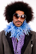 Ben Jamin with afro hair and feather boa at the Glastonbury festival 2007