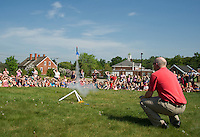 Gilford High School Tech Ed teacher Sean Walsh shows Gilford Elementary launches an Estes Rocket on the cemetery field for Stem Day (science, technology, engineering and math) on Wednesday morning.  (Karen Bobotas/for the Laconia Daily Sun)