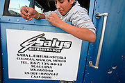 19 DECEMBER 2008 -- NOGALES, SON, MEX: Alejandro Iribe waits for his dad to get in the truck before they drive into the US from the Mexican side of the Mariposa port of Entry in Nogales. PHOTO BY JACK KURTZ
