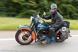 """Scott Wages, the """"Golden Ticket"""" winner, won the opportunity to ride the entire Cannonball on this 1936 Harley-Davidson Knucklehead from Carl's Cycle, shown here during Stage 2 of the Motorcycle Cannonball Cross-Country Endurance Run, which on this day ran from Lake City, FL to Columbus, GA., USA. Saturday, September 6, 2014.  Photography ©2014 Michael Lichter."""