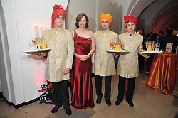 Actress SIGOURNEY WEAVER and waiters at the Royal Rajasthan Gala 2009 benefiting the Indian Head Injury Foundation held at The Banqueting House, Whitehall, London on 9th November 2009.