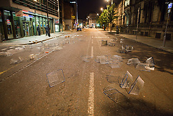 © Licensed to London News Pictures. 10/08/2011. Salford, UK. Outside Tesco on Princess Street, opposite Manchester Town Hall. Scenes of desctruction in Manchester, where people rioted and looted and premesis were set alight. Photo credit : Joel Goodman/LNP