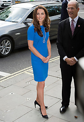 © Licensed to London News Pictures. 19/07/2012. London, UK. Catherine Duchess of Cambridge being greeted by Sandy Nairne, Director of the National Portrait Gallery as she arrives at the National Portrait Gallery  on London on July 19, 2012 for a viewing of an exhibition titled BT Road To 2012: Aiming High.  Highlights of the exhibition include portraits of gymnast Beth Tweddle and sprinter Jodie Williams. The exhibition opens today (19/07/2012) and runs to September 23 as Part of the London 2012 Festival. Photo credit : Ben Cawthra/LNP