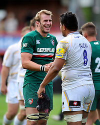 Leicester Tigers flanker Tom Croft has a word with Worcester Warriors number 8 Semisi Taulava after the match - Photo mandatory by-line: Patrick Khachfe/JMP - Tel: Mobile: 07966 386802 - 08/09/2013 - SPORT - RUGBY UNION - Welford Road Stadium - Leicester Tigers v Worcester Warriors - Aviva Premiership.