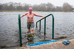 © Licensed to London News Pictures. 26/02/2018. London, UK. Members of the Serpentine Swimming Club brave the 2°C waters of the Serpentine in Hyde Park as snow falls. Severe cold, blizzards and heavy snow are expected as the 'Beast from the East' brings freezing Siberian air to the UK. Photo credit: Rob Pinney/LNP