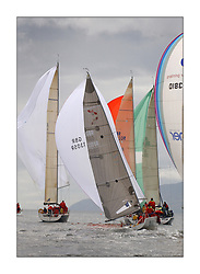 Yachting- The first days inshore racing  of the Bell Lawrie Scottish series 2003 at Tarbert Loch Fyne.  Light shifty winds dominated the racing...Dave Ovington in his Mumm 30 Ovington Boats hits a gust as the Clss one fleet head downwind...Pics Marc Turner / PFM