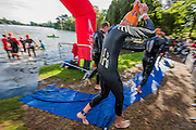 Transition between the swimming and cycling - Competitors enjoy the warm sunny conditions while participating in the Hever castle Triathlon.
