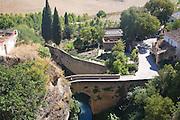 Puente San Miguel crossing the Rio Guadalevin river , Ronda, Spain historic bridge