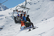British freestyle ski and snowboard athletes Katie Ormerod, Isabel Atkin, Cal Sandieson & Matt McCormick on a chairlift on 05th May 2017 in Corvatsch, Switzerland. Piz Corvatsch is a mountain in the Bernina Range of the Alps, overlooking Lake Sils and Lake Silvaplana in the Engadin region of the canton of Graubünden.