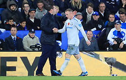Everton's Wayne Rooney shakes haves with Everton caretaker manager David Unsworth as he is substituted during the Premier League match at the King Power Stadium, Leicester.