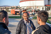 """Father Abdush (middle) and his sons Mersid (right) and Erdal preparing for a drum session on a stage in front of the """"House of Culture"""" in Delcevo, Macedonia. The Roma family - father and his 3 sons - are well know for their drum perfomances and also they build their drums themselves."""