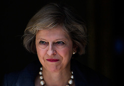 © Licensed to London News Pictures. 26/07/2016. London, UK. British prime minister THERESA MAY leaves 10 Downing Street in London to greet Taoiseach Enda Kenny (not pictured) . The pair are expected to discuss impact of Britain's recent vote for Brexit. Photo credit: Ben Cawthra/LNP