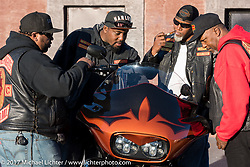 Othello Daley of Waldorf, MD shows off his bike to his buddies at what has come to be known as Black Bike Week during Daytona Bike Week. Daytona Beach, FL. USA. Thursday March 16, 2017. Photography ©2017 Michael Lichter.
