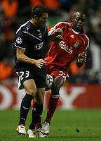 Photo: Paul Thomas.<br /> Liverpool v Bordeaux. UEFA Champions League, Group C. 31/10/2006.<br /> <br /> Momo Sissoko of Liverpool (R) and Florian Marange go for the ball.