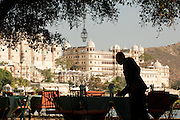 A restaurant terrace overlooking the City Palace and Lake Pichola. Udaiper, also known as the City of Lakes, Rajasthan, India