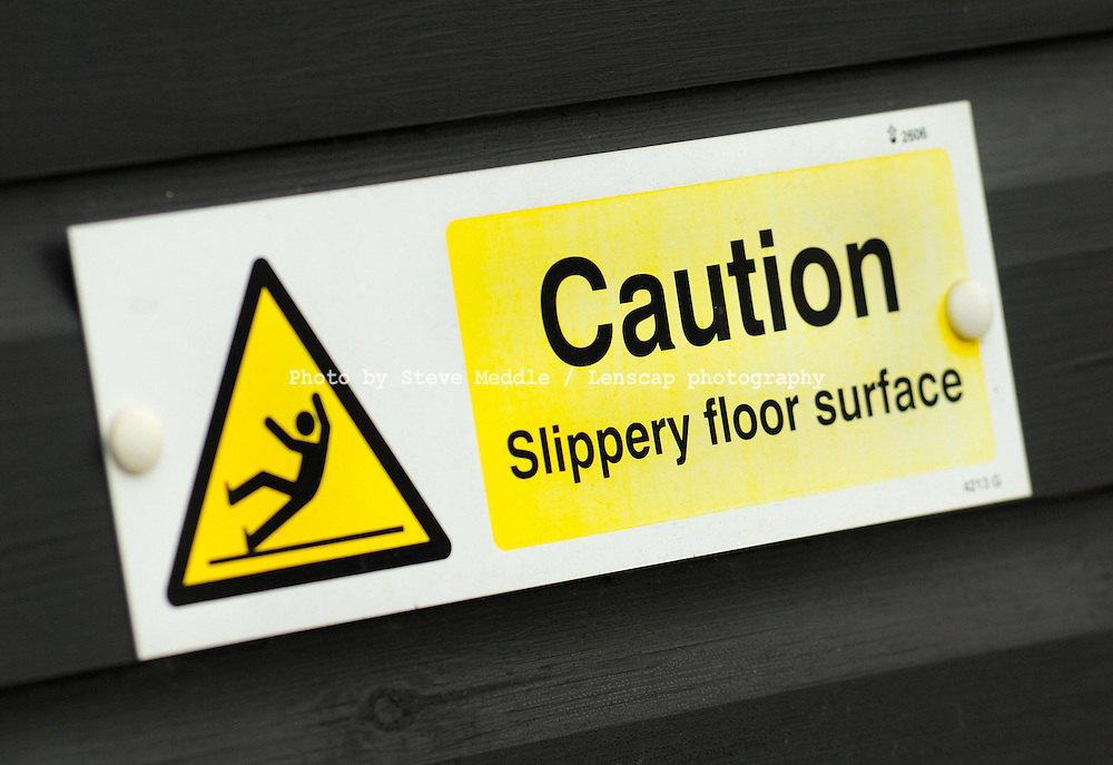 Caution Slippery Floor Surface Warning Sign - Aug 2009