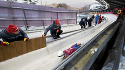 February 8, 2018 - Pyeongchang, South Korea - Romania's Valentin Cretu, foreground, has an audience during the Luge Men's singles training runs the evening before the opening ceremonies of the 2018 Pyeongchang Winter Olympics. (Credit Image: © Daniel A. Anderson via ZUMA Wire)