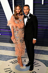 Chrissy Teigen (left) and John Legend attending the Vanity Fair Oscar Party held at the Wallis Annenberg Center for the Performing Arts in Beverly Hills, Los Angeles, California, USA.