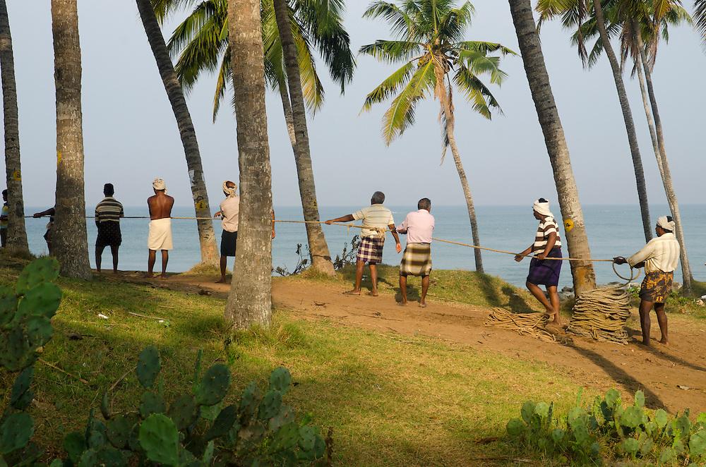 Men fishing on Varkala beach, Kerala, Indian Subcontinent