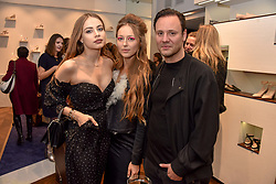 Left to right, Xenia Tchoumi, Liza Urla and Nicholas Kirkwood at a party hosted by Nicholas Kirkwood and Eva Fehren to celebrate Part 2 in the Nicholas Kirkwood presents series held at Nicholas Kirkwood, 5 Mount Street, London England. Eva Fehren is a fine jeweller, born and raised in New York City. Her collections are both inspired and created in the city, and via the Nicholas Kirkwood store, it is the first opportunity to view and shop the collection in London. 9 November 2017.