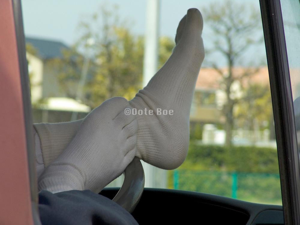 Japanese trucker taking a break wearing funny socks
