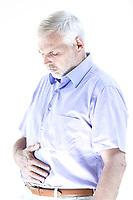 caucasian senior man portrait suffer stomachache isolated studio on white background