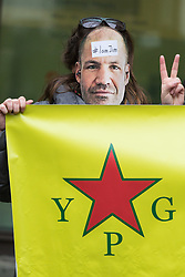 A supporter of James Matthews holds up a YPG banner at Westminster Magistrates Court where he faces a charge of attending a place used for terrorist training, under the Terrorism Act 2006, after fighting against ISIS with the Kurdish YPG militia. London, February 14 2018.