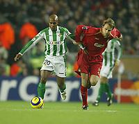Photo: Aidan Ellis.<br /> Liverpool v Real Betis. UEFA Champions League.<br /> 23/11/2005.<br /> Liverpool's Dietmar Hamann challenges Betis Marcos Assuncao